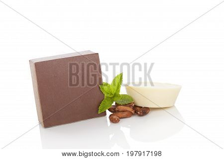 Natural cosmetics. Cocoa massage soap with cocoa seeds and mint isolated on white background.