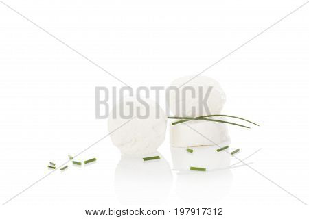 Goat cheese with sliced Chive isolated on white background. Culinary goat cheese eating.