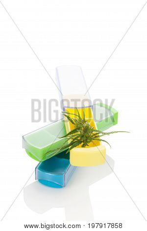 Weekly Marijuana dole in Pill Box with Marijuana bud isolated on white background. Medical marijuana.
