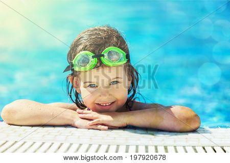 Pool girl swimming elementary age human emotions cute girl blue