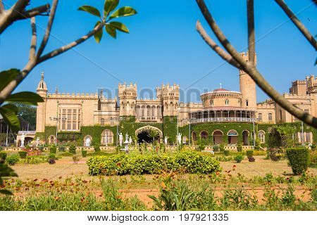 Main buildings of Bangalore Palace With blurred tree branches in the foreground Bangalore Karnataka India poster