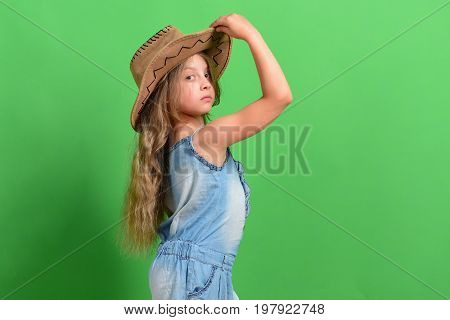 Kid With Serious Face And Fair Hair Wears Jeans Dress