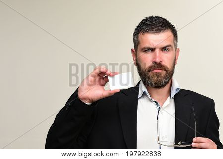 Guy With Grumpy Face And Glasses On Light Grey Background