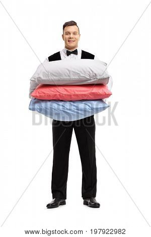 Full length portrait of a butler with pillows isolated on white background