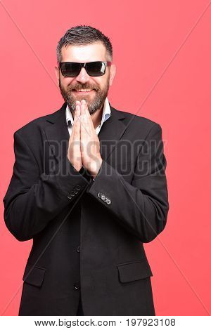 Guy With Happy Face And Sunglasses Isolated On Salmon Pink