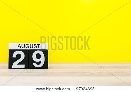 August 29th. Image of august 29, calendar on yellow background with empty space for text. Summer time.