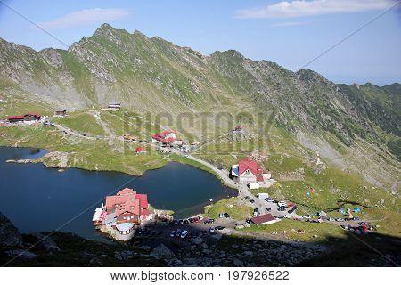 Mountain huts near Balea lake during sunny day in Fagaras Mountains, Romania