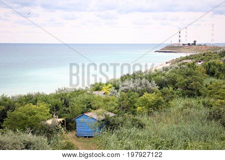Blue cabin at seaside - exotic beach with forest and blue water