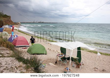 Camping on the beach during stormy weather