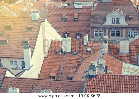 Houses with traditional red roofs with sunlight in Prague Mala Strana district in the Czech Republic