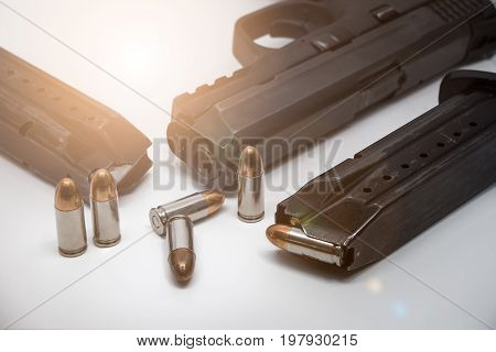 9 mm Pistol bullets and magazine on white background. Gun isolated