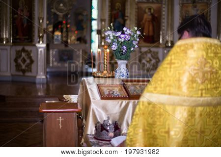 the priest standing with his back to the altar in the temple Orthodox Church.