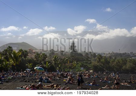 PUERTO DE LA CRUZ TENERIFE CANARY ISLANDS - JANUARY 12 2014: The coast of Atlantic ocean in Puerto De La Cruz one of the most popular touristic towns Canary islands Spain