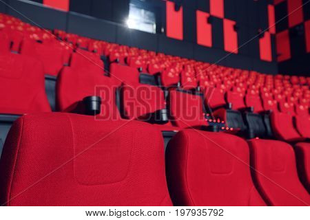 Cinema hall with red armchairs. the empty hall. the interior of the cinema