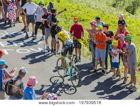 Col du Grand ColombierFrance - July 17 2016: The Belgian cyclist Maarten Wynants of LottoNL-Jumbo Team riding on the road to Col du Grand Colombier in Jura Mountains during the stage 15 of Tour de France 2016.