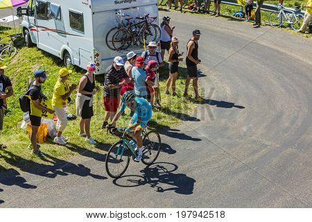 Col du Grand ColombierFrance - July 17 2016: The Danish cyclist Jakob Fuglsang of Astana Team riding on the road to Col du Grand Colombier in Jura Mountains during the stage 15 of Tour de France 2016.