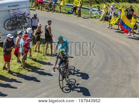 Col du Grand ColombierFrance - July 17 2016: Daniel Moreno of Movistar Team and Luis Leon Sanchez of Astana Team riding on the road to Col du Grand Colombier in Jura Mountains during the stage 15 of Tour de France 2016.