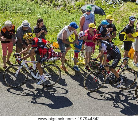 Col du Grand ColombierFrance - July 17 2016: Amael Moinard of BMC Team and Emanuel Buchmann of Bora-Argon 18 Team riding on the road to Col du Grand Colombier in Jura Mountains during the stage 15 of Tour de France 2016.
