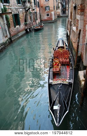 Scene in Venice Italy, with gondola in the channel