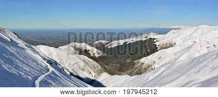 Panoramic landscape view of The Canterbury Plains from the Mount Hutt Ski Field in New Zealand.