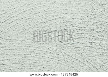 Whitewash lime textured grainy uneven background wide brushstrokes in semi circle shape blotchiness