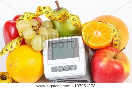 Blood Pressure Monitor, Fresh Ripe Fruits With Vegetables And Tape Measure