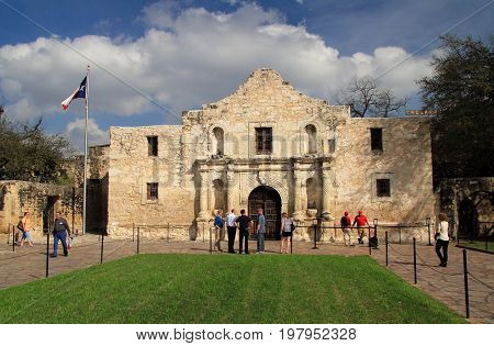 SAN ANTONIO, TX - FEBRUARY 27: Tourists and locals enjoy a visit to the historic Alamo compound, one of San Antonio's main attractions February 27, 2017 in San Antonio, TX.
