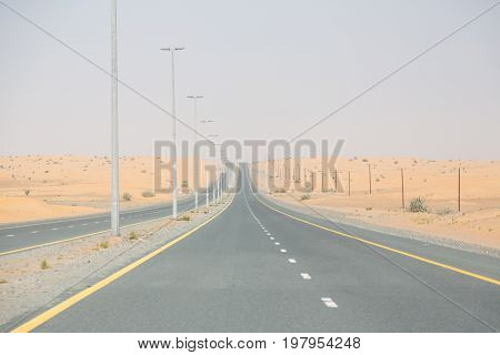 a two-lane highway running through the desert