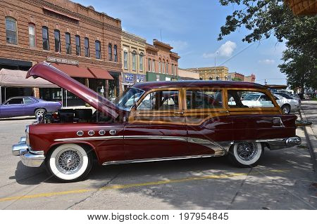 CASSELTON, NORTH DAKOTA, July 27, 2017: The annual Casselton Car Show which occurs the last Thursday of July features classic vehicles such as the rare 1953 Woody Buick wagon.