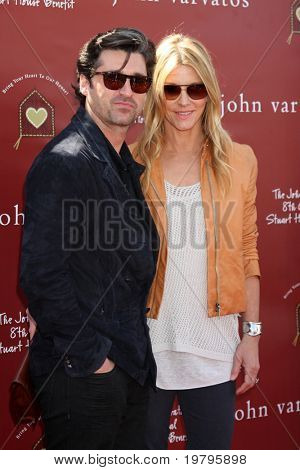 LOS ANGELES - MAR 13:  Patrick Dempsey, .Jill Fink Dempsey arriving at the John Varvatos 8th Annual Stuart House Benefit at John Varvaots Store on March 13, 2011 in Los Angeles, CA