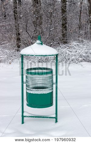 Green Metal Garbage Bin In Park At Winter