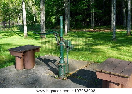 FIFE LAKE, MICHIGAN / UNITED STATES - MAY 27, 2017: The Michigan Department of Transportation Roadside Park, honoring J. Charles Brown, on U.S. Highway 131, offers a pump where motorist may obtain potable well water.