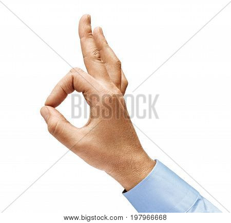 Man's hand in a shirt shows gesture okay. Positive concept. Close up. High resolution