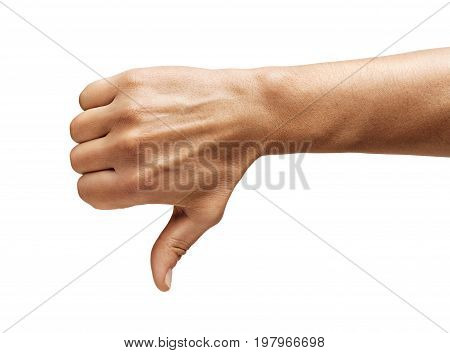 Men's hand shows thumb down isolated on white background. Negative concept. Close up. High resolution.