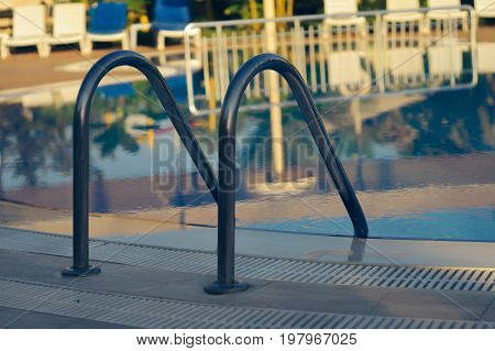 Pool with handrails view on clear water