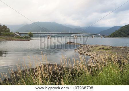 Kawaguchi bridge with lake and mountain background in Japan.
