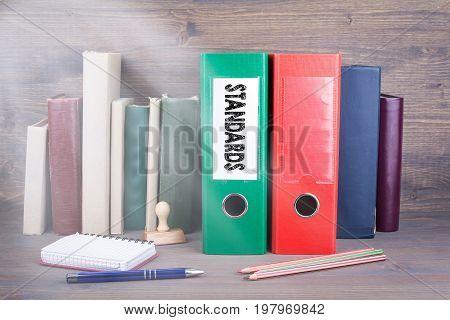 Standards. Binder on desk in the office. Business background.