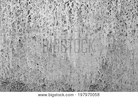 Gray cement wall with holes textured background