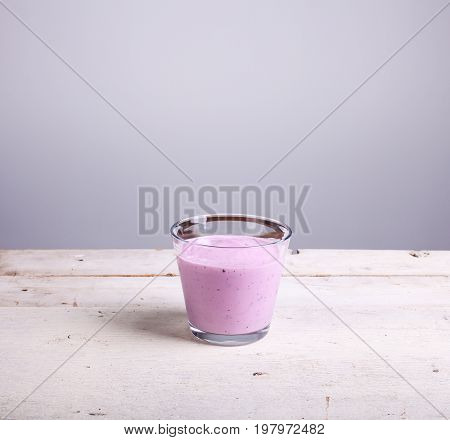 Yogurth with fresh berries on white table
