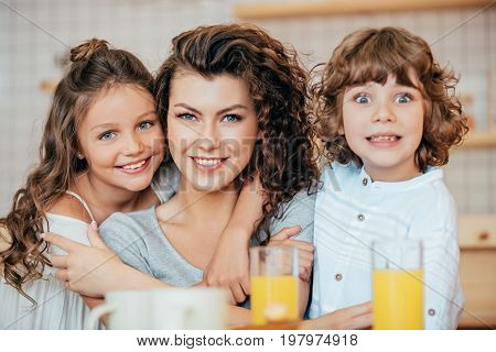 potrait of mother with her cute little kids