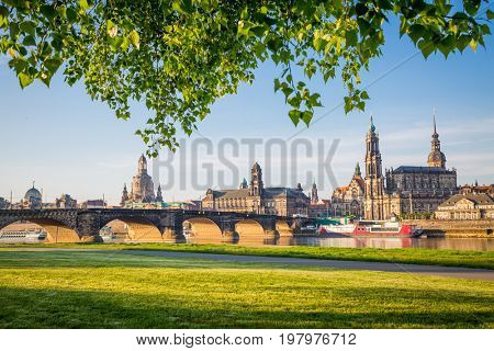 The embankment of ancient city on the Elbe river. Popular tourist attraction. Location place German city of Dresden, famous Saxony land, historical and cultural center of Europe. Beauty world.