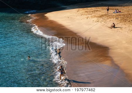 San Juan Tenerife Canary islands Spain - May 27 2017: Aerial view of a small Abama beach on the west coast of Tenerife close to San Juan. Blue waves and golden sand.