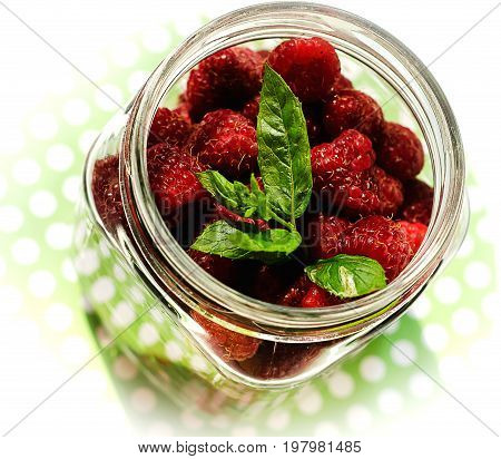 Fresh raspberry and mint. Natural organic vitamins - healthy food photo concept