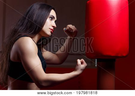 Woman Boxing, Hitting A Punching Dummy