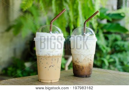 Ice cappuccino and latte coffee on wooden table