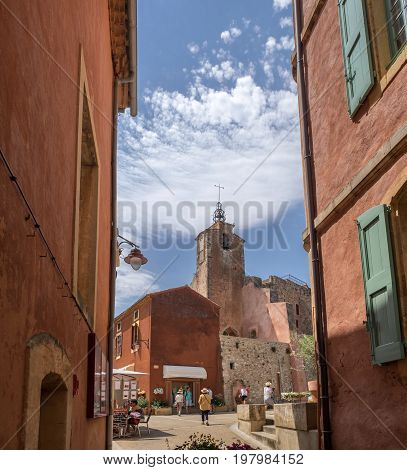 View On Small Square With Red Houses And Gift Shops At Village Of Roussillon, Provence, France