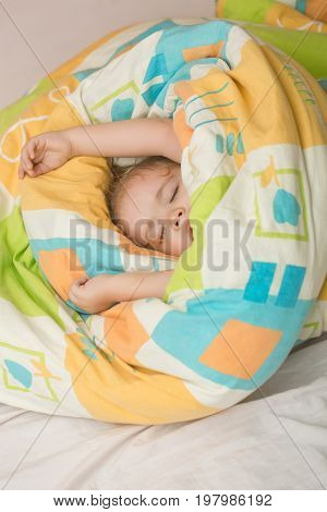 Sleepy baby in colorful blanket. Childhood and happiness. Small baby dreaming. Trust and tenderness. Child sleep in bed.