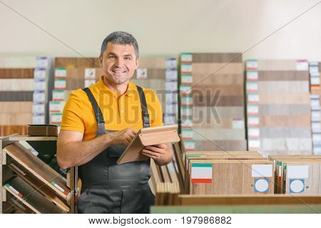 Carpenter choosing laminate samples in hardware store