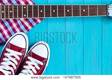 Burgundy Sneakers, Checkered Shirt And Guitar Fretboard On Brigh