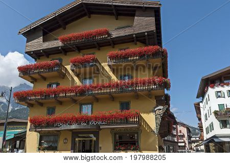 Cortina d'Ampezzo, Italy - September 24, 2011:  Autumnal corso Italia, the main street in the town centre, Cortina d'Ampezzo, Dolomites, Alps, Veneto,  Italy, Europe. Visit in the place.